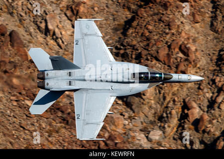United States Navy Boeing F/A-18F Super Hornet (NJ 174) from the VFA-122 Flying Eagles squadron, Naval Air Station Lemoore, flies low level on the Jedi Transition through Star Wars Canyon / Rainbow Canyon, Death Valley National Park, Panamint Springs, California, United States of America Stock Photo