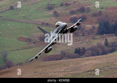 Royal Air Force Eurofighter Typhoon FGR4 flies low level through the Mach Loop, Machynlleth, Wales, United Kingdom - Stock Photo