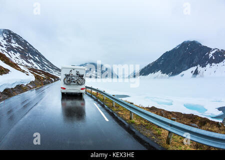 Caravan car travels on the highway. Beautiful Nature Norway natural landscape.