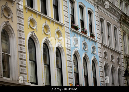 Bright painted buildings on Museum Street in London the capital city of England - Stock Photo