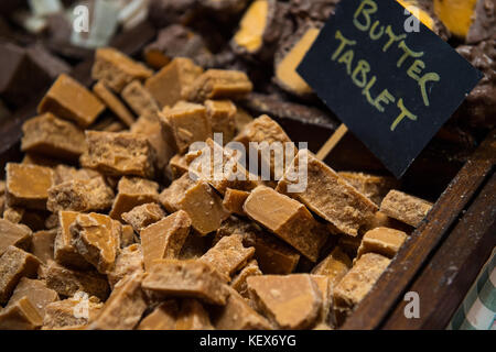 Delicious chunks of homemade butter tablet on display in Edinburgh during christmas market - Stock Photo