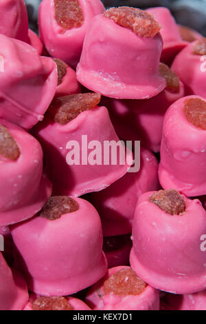 Delicious chunks of homemade strawberry sweets on display in Edinburgh during christmas market - Stock Photo
