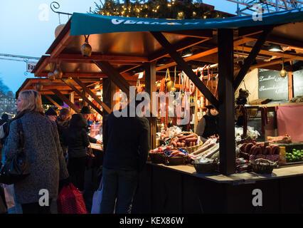 EDINBURGH, SCOTLAND, UK – December 08, 2014 - People walking among german christmas market stalls in Edinburgh, - Stock Photo