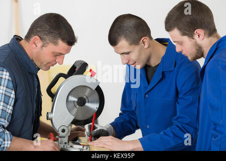 the young male carpenters - Stock Photo