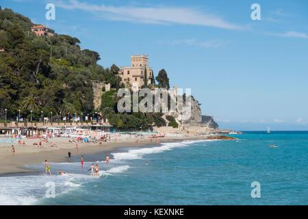 The beach of Finale Marina in Italian holiday region Finale Ligure at the Mediterranean Sea. - Stock Photo