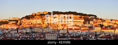 The historical centre and São Jorge castle in the evening. Lisbon, Portugal - Stock Photo