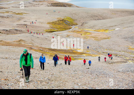 Passengers on an expedition cruise to Anarctica recreat part of Shakleton's famous walk across South Georgia. The - Stock Photo