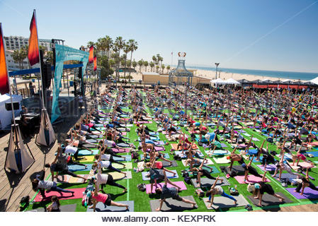 View from above of people stretching during outdoor yoga festival on Santa Monica Pier in Santa Monica, California, - Stock Photo