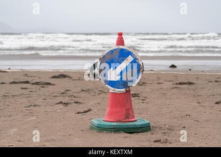 Traffic cone on beach - Stock Photo