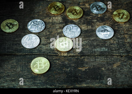 Many golden and silver bitcoins on a wooden surface, background with vintage effect, cryptocurrency concept for - Stock Photo