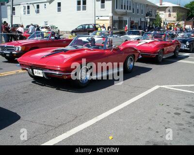 Two red Corvettes on Main Street, Watkins Glen, NY for Grand Prix Festival.