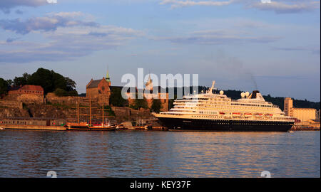 OSLO, NORWAY ON JUNE 30, 2009. View of MS Prinsendam moored at Akershus Fortress in Oslo harbor. Sunny evening. - Stock Photo
