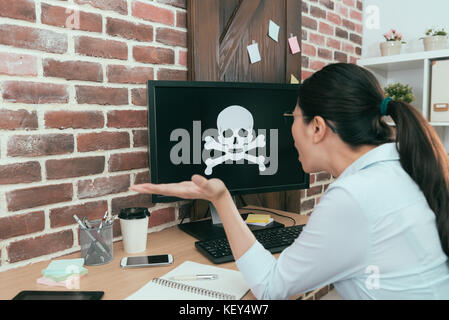 back view photo of young business woman personal working computer poisoning when she doing work report feeling unhappy - Stock Photo