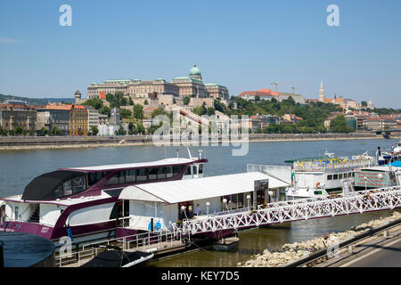 View of the Royal Buda Palace on Castle Hill across the Danube river from the Pest side. - Stock Photo