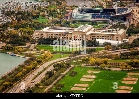 Looking out towards Chicago's iconic Field Musuem and Soldier Field from the Aon Tower - Stock Photo