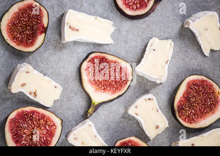 Camembert and fresh figs on stone slate, top view. - Stock Photo