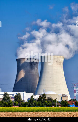 Steam rising from the two cooling towers of the  Nuclear Power Plant at the small village if Doel in Flanders, Belgium - Stock Photo
