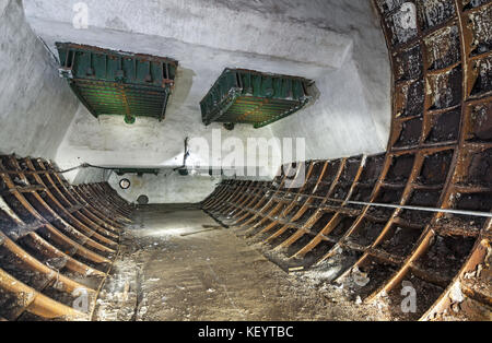 Abandoned old forgotten technical subway room. Emergency ventilation latch in the line end of the underground tunnel - Stock Photo