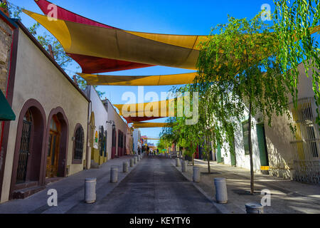 January 16, 2016 Monterrey, Mexico: shade installed over the street in the historic old town called 'Barrio Antiguo' - Stock Photo