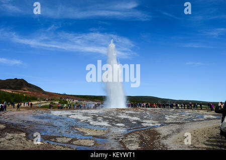 Geyser Strokkur erupting in haukadalur geothermal area in Iceland - Stock Photo