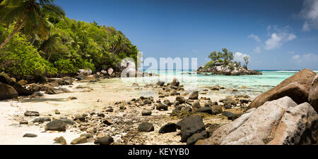 The Seychelles, Mahe, Anse Royale, Ile Souris, beach, at low tide, panoramic - Stock Photo