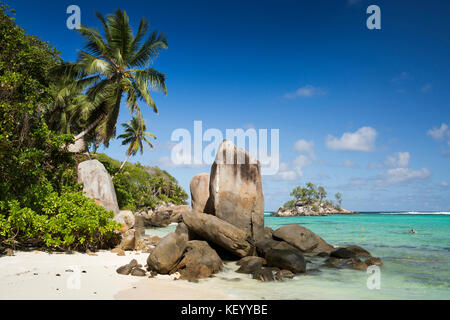 The Seychelles, Mahe, Anse Royale, Ile Souris, beach, granite rock formation sculpted by the sea - Stock Photo