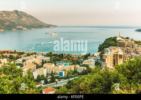 View of the hotels and the crowded beaches of the resort town of Becici, Budva Riviera, Montenegro. - Stock Photo