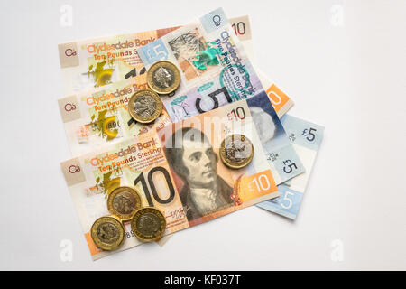 New plastic polymer Clydesdale Bank Scottish ten £10, five pounds £5 banknotes and new hexagonal one pound £1 coins, - Stock Photo