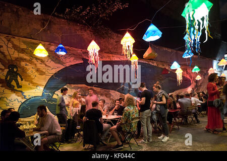 Horizontal view of a ruinpub in Budapest at night. - Stock Photo