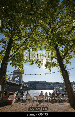 Vertical view of a pop-up bar on the banks of the river Danube in Budapest. - Stock Photo