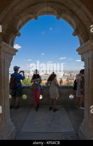 Vertical view of tourists admiring the view from the Fisherman's Bastion in Budapest. - Stock Photo