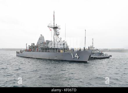 The U.S. Navy Avenger-class mine countermeasures ship USS Chief arrives at Jeju Island for a port visit September - Stock Photo