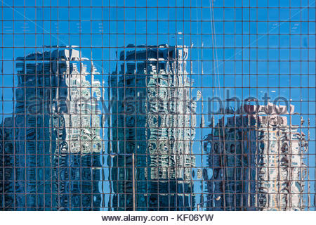 Condo buildings reflected in office building glass curtain wall in Scarborough area of Toronto Ontario Canada - Stock Photo
