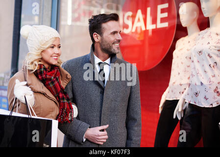 Lovely couple doing the shopping in the city - Stock Photo
