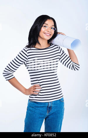 Cheerful female engineer posing with a blueprint - Stock Photo