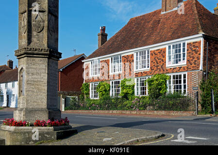 High Street and war memorial in the village of Burwash, Sussex, England UK - Stock Photo