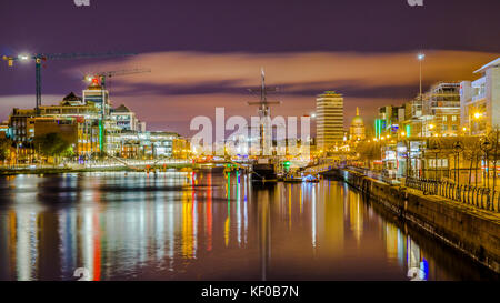 Dublin, Ireland, night view of Samuel Beckett Bridge to Jeanie Johnston Tall Ship against the background of the - Stock Photo