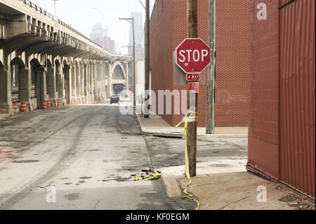 Stop sign in empty street along bridge in Kansas City, Missouri, USA - Stock Photo