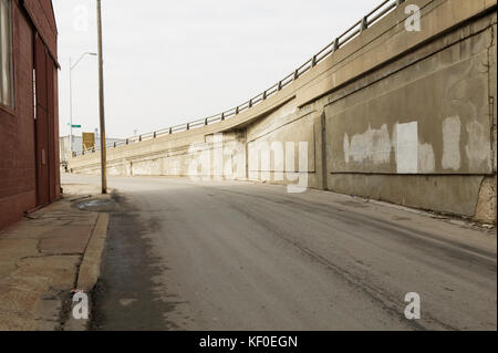 Empty street by concrete bridge in Kansas City, Missouri, USA - Stock Photo