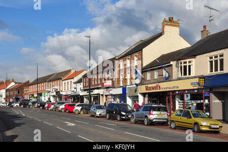 Shops and parked cars in High Street, Northallerton, North Yorkshire, England, UK - Stock Photo