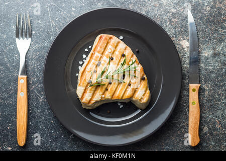 Grilled tuna steak on plate. - Stock Photo