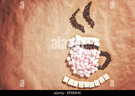 Mug cup of hot coffee cocoa from pink marshmallows and grain coffee on old paper background. Christmas New Year - Stock Photo