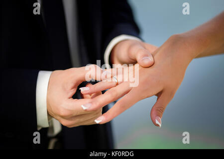 The bridegroom puts the ring on the bride. - Stock Photo
