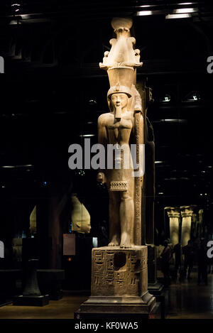 Turin. Italy. Portrait statue of Egyptian Pharaoh Seti II wearing an Atef crown. Museo Egizio (Egyptian Museum) - Stock Photo