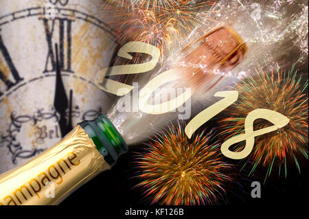 popping champagne and fireworks at silvester and new years eve 2018 - Stock Photo