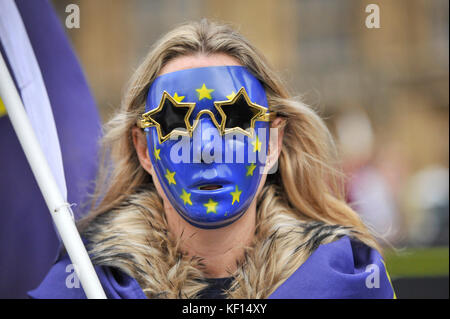 London, UK.  24 October 2017.  An anti-Brexit, pro-Europe supporter wears a mask decorated with the European flag outside the Houses of Parliament.   Credit: Stephen Chung / Alamy Live News Stock Photo