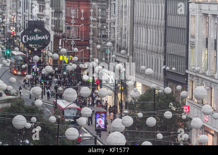 London, UK. 24th Oct, 2017. Large balls like falling snow flakes  decorate the length of Oxford Street for Christmas - Stock Photo