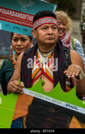 London, UK. October 24, 2017 - Guardians of the Forest, indigenous leaders from Latin America, Indonesia and Africa, hold a rally in Parliament Square to commemorate those who have lost their lives defending the forests against mining, the cutting down of forests for palm oil production and other crops and other threats to the forests and those who live in them and they held up pictures of a few of the many who have been murdered for the profit of unscrupulous companies - including many listed on stock exchanges in London and elsewhere. Credit: ZUMA Press, Inc./Alamy Live News Stock Photo