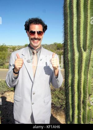RELEASE DATE: November 3, 2006. Director: Larry Charles. Borat poses with his new American friend a cactus. Borat: - Stock Photo