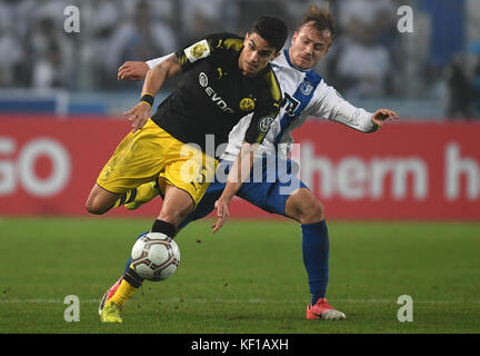 Magdeburg, Germany. 24th Oct, 2017. Dortmund's Marc Bartra (L) and Magdeburg's Felix Lohkemper vie for the ball - Stock Photo